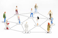 Networking. People miniature figurines connected, as concept for social networking Royalty Free Stock Photography