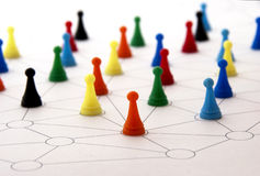 Networking. Concept with colorful plastic people or checkers - , organizational groups, or workgroups - Business concept - the focus is on red people group