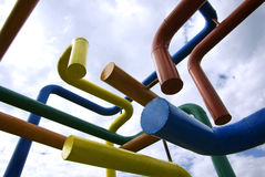 Networking. Concept. Colored pipes network against blue sky royalty free stock photos
