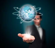 Networking. Businessman with a global network Stock Image