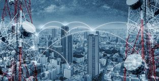 Free Networking And Internet Network Technology In The City. Telecommunication Towers With Cityscape And Networking Line Royalty Free Stock Photography - 136057547