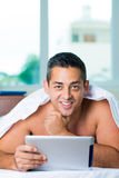Networking in bed Royalty Free Stock Photography