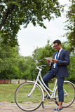 Networking on bicycle Royalty Free Stock Image