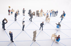 Networking Concept. Miniature people in a triangular network Royalty Free Stock Photos
