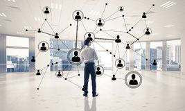 Networking and social communication concept as effective point f. Elegant businessman in 3D office interior and social connection concept. Mixed media Royalty Free Stock Images