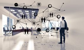 Networking and social communication concept as effective point f. Elegant businessman in 3D office interior and social connection concept. Mixed media Stock Photos