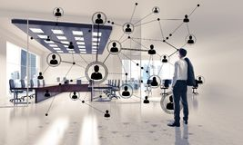 Networking and social communication concept as effective point f. Elegant businessman in 3D office interior and social connection concept. Mixed media Stock Images