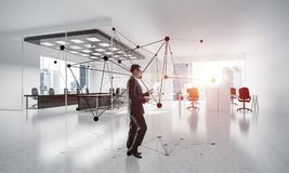 Networking and social communication concept as effective point f. Elegant businessman in modern office interior and social connection concept. Mixed media Stock Photo