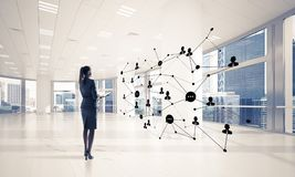 Networking and social communication concept as effective point f. Elegant businesswoman in 3D office interior and social connection concept. Mixed media Stock Photos