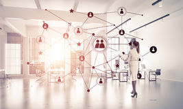 Networking and social communication concept as effective point f. Elegant businesswoman in 3D office interior and social connection concept. Mixed media Royalty Free Stock Images