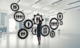 Networking and social communication concept as effective point f. Elegant businesswoman in modern office interior and social connection concept. Mixed media Stock Image