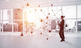 Networking and social communication concept as effective point for modern business. Elegant businessman in 3D office interior and social connection concept Stock Photography