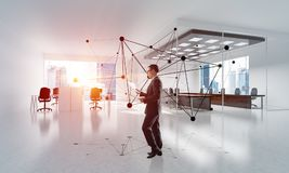 Networking and social communication concept as effective point for modern business. Elegant businessman in modern office interior and social connection concept Royalty Free Stock Images
