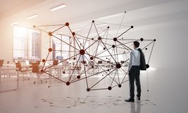 Networking and social communication concept as effective point for modern business. Elegant businessman in modern office interior and social connection concept Stock Photography