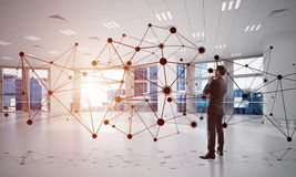 Networking and social communication concept as effective point for modern business. Elegant businessman in modern office interior and social connection concept Royalty Free Stock Image