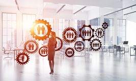 Networking and social communication concept as effective point for modern business. Elegant businesswoman in modern office interior and social connection concept Stock Photo