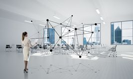 Networking and social communication concept as effective point for modern business. Elegant businesswoman in modern office interior and social connection concept Stock Images
