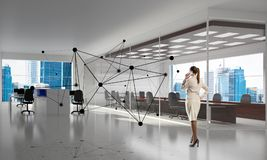 Networking and social communication concept as effective point for modern business. Elegant businesswoman in modern office interior and social connection concept Royalty Free Stock Photography