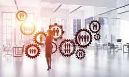 Networking and social communication concept as effective point for modern business. Elegant businesswoman in modern office interior and social connection concept Stock Image