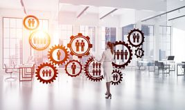 Networking and social communication concept as effective point for modern business. Elegant businesswoman in modern office interior and social connection concept Royalty Free Stock Image