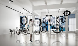 Networking and social communication concept as effective point for modern business. Elegant businesswoman in modern office talking mobile phone and social Stock Photos