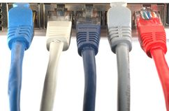 Networks. Different network cables plugged in Royalty Free Stock Photos