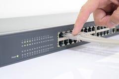 Netzschalter und Ethernet-Kabel Lizenzfreies Stockfoto