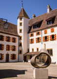 Neuchatel Chateau, Switzerland. Courtyard with brightly coloured window shutters and sculpture in the historic chateau in Neuchatel, Switzerland Royalty Free Stock Photo