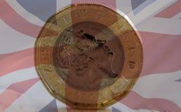 Neue Briten eine Pfund-Münze gemischt mit Union Jack A Lizenzfreie Stockbilder
