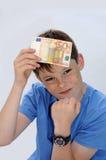 Neue Dollarrolle in der Hüftetasche der abgenutzten Blue Jeansnahaufnahme Lizenzfreie Stockbilder