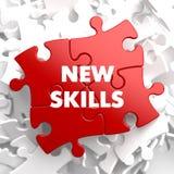 Neue Fähigkeiten auf rotem Puzzlespiel Lizenzfreies Stockbild