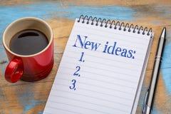 Neue Ideenliste im Notizbuch Stockfotos