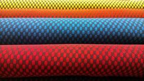 Neue industrielle Gelbe, Orange, Graue, Blau und Veilchen rollen Hintergrund Konzept: Material, Gewebe, Fertigung, Kleiderfabrik, Stockbilder