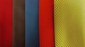Neue industrielle Gelbe, Orange, Graue, Blau und Veilchen rollen Hintergrund Konzept: Material, Gewebe, Fertigung, Kleiderfabrik, Lizenzfreie Stockbilder