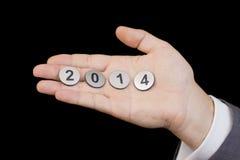 Neue 2014-jährige Zahlen in der Hand Stockfotos