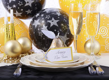 Neue Jahre Eve Dinner Table Place Setting Stockfoto