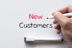 Neue Kunden geschrieben auf whiteboard Lizenzfreies Stockfoto