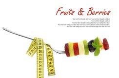 Neue Mischscheiben von Früchten auf einer Gabel lizenzfreies stockfoto