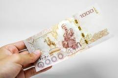 Neue tausend Bahtbanknote in der Hand Stockbilder