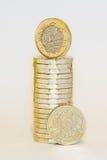 Neue und alte -Pfund-Münzen Stockbild