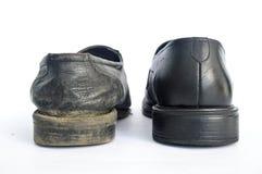 Neue und benutzte Schuhe Stockfotos