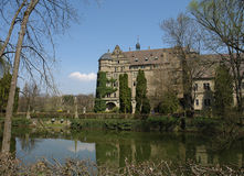 Neuenstein Castle. Is surrounded by an old garden and a moat-like castle pond. The picture was taken on a bright but cold early spring day Stock Images