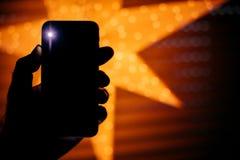 Neuer Begrifflichsmartphone mit Stern im Hintergrund perfekter ch Stockfotos