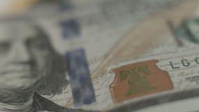 Neuer 100 Dollarschein U S Papiergeldnahaufnahme, gefälschte Anmerkung stock video