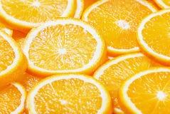Neuer natürlicher Hintergrund mit orange Scheibe Stockfoto