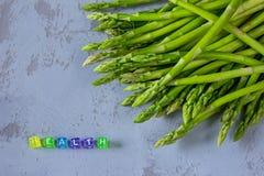 Neuer Spargel der gesunden Ernte und ` GESUNDHEIT ` lizenzfreies stockbild