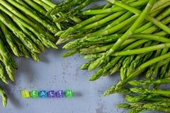 Neuer Spargel der gesunden Ernte und ` GESUNDHEIT ` lizenzfreies stockfoto