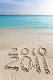 Neues 2011. Die Welle wäscht weg eine Beschreibung 2010 Lizenzfreie Stockfotografie