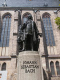 Neues Bach Denkmal. The Neues Bach Denkmal meaning new Bach monument in front of the St Thomas Kirche church where Johann Sebastian Bach is buried in Leipzig Royalty Free Stock Images