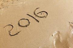 Neues Jahr 2016 auf Sand Lizenzfreies Stockfoto